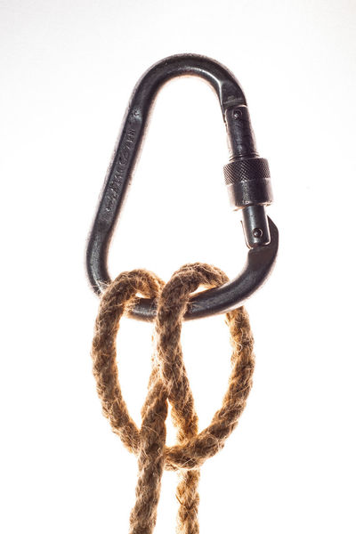Clove hitch knot in use in climbing, sailing ect. Clove Hitch Knot Rope Climbing Sailing White Background Studio Shot Metal Close-up No People Connection Still Life White Color Iron - Metal Security
