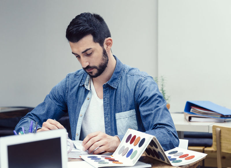 Beard Brainstorming Casual Clothing Caucasian Color Chart Coworking Coworkingspace Design Designer  Documentary European  Ideas Laptop Meeting Notebook Office One Person Project Startup Teamwork Technology Work Young Adult