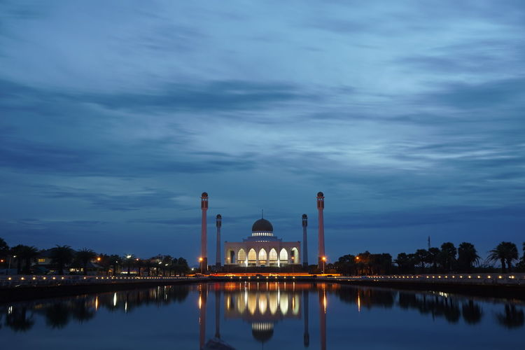 Mosque Reflecting In Lake Against Sky At Dusk