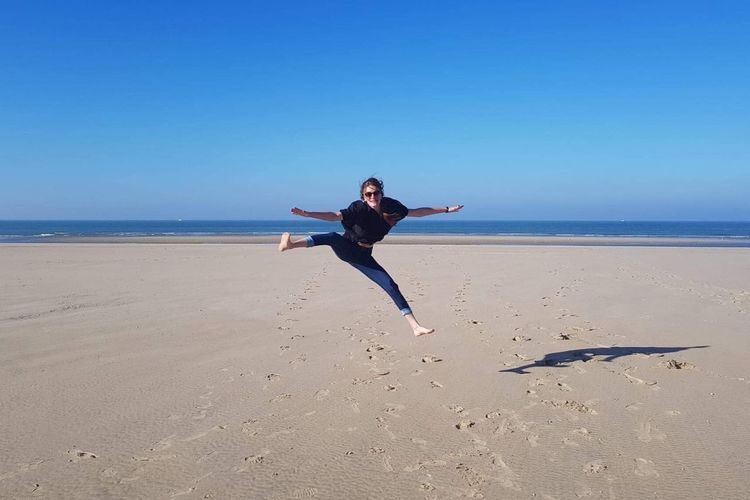 Light And Shadow Sun France Sky Beach Land Sea Full Length Sky Water Human Arm Happiness Leisure Activity Nature Jumping Blue Real People Casual Clothing Fun