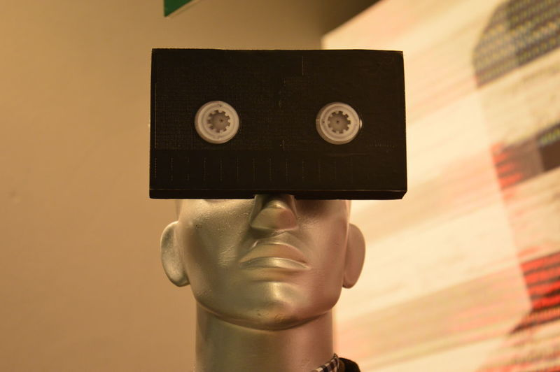 Close-up of audio cassette with mannequin