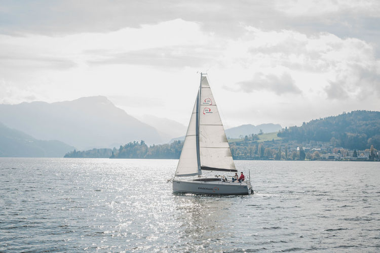 Random boat at Lucerne, Switzerland Water Nautical Vessel Mountain Sky Transportation Sea Waterfront Mode Of Transportation Beauty In Nature Cloud - Sky Sailboat Sailing Day Nature Scenics - Nature Tranquil Scene Outdoors Sailling Lake Landscape View