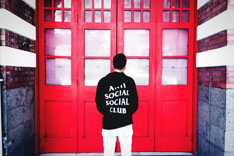 City Outdoors Street People Cityscape Day City Life Antisocial Antisocialsocialclub Streetwear Singapore Rear View Red Adults Only One Person Adult Young Adult Standing