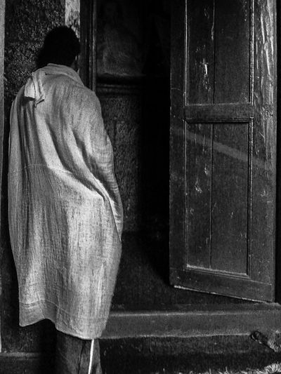 Facing Away Rear View Orthodox Church Time Of Peaceful Moments Antique Wooden Doors Man Standing In Doorway EthiopianOrthodoxTewahedoChurch