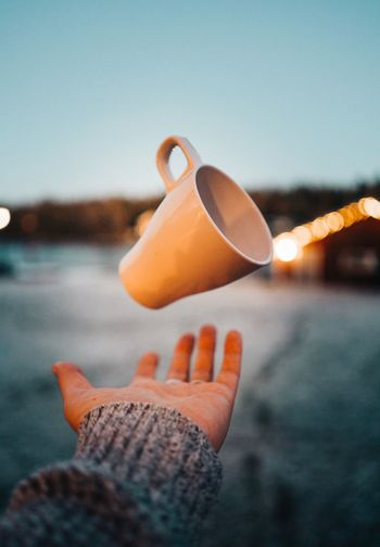 Coffee Hot Drink Winter Lifestyles Love Coffee Cup Flying Drinks Coffee Human Hand Hand Holding One Person Focus On Foreground Close-up Human Body Part Sky Personal Perspective Lifestyles Food Nature Day Real People Body Part