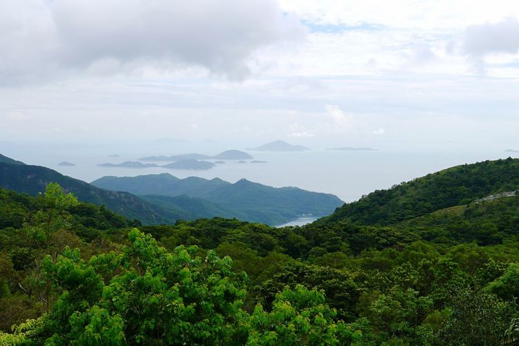 Hong Kong outer islands Islands HongKong Travel Destinations Beauty In Nature Scenics - Nature Mountain Cloud - Sky Sky Plant Tranquility Green Color Tranquil Scene Growth Mountain Range Landscape Environment Non-urban Scene Nature Idyllic Land No People Day