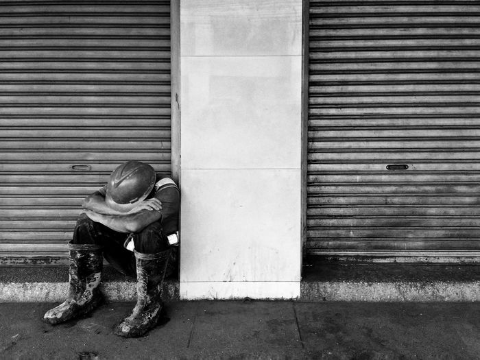 Worker Sleeping On Street