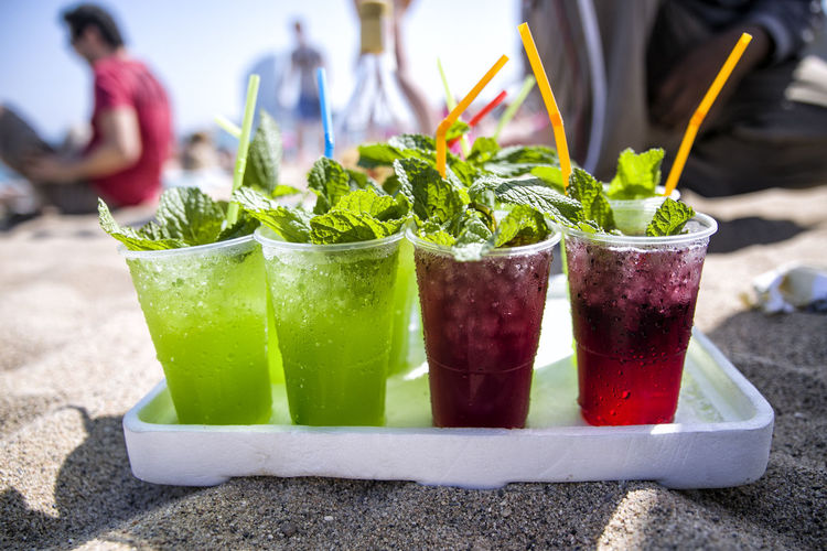 Close-Up Of Drinks On Beach