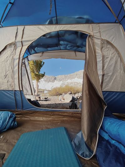 Tent in water against blue sky