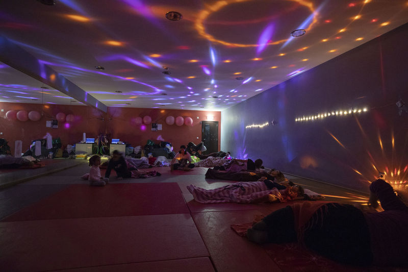 Portugal; Aula de Yoga Yogagirl Illuminated Group Of People Real People Lighting Equipment Indoors  Large Group Of People Crowd Night Arts Culture And Entertainment Leisure Activity Men Light Adult Ceiling Lifestyles Women Light - Natural Phenomenon Architecture Enjoyment Nightlife