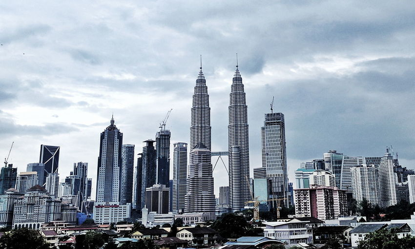 Kuala Lumpur. Skyscraper City Travel Destinations Cityscape Urban Skyline Architecture Building Exterior Travel Tower Business Finance And Industry Modern Business Outdoors Sky City Life Financial District  No People Downtown District Cloud - Sky Day Kuala Lumpur KLCC Twin Towers