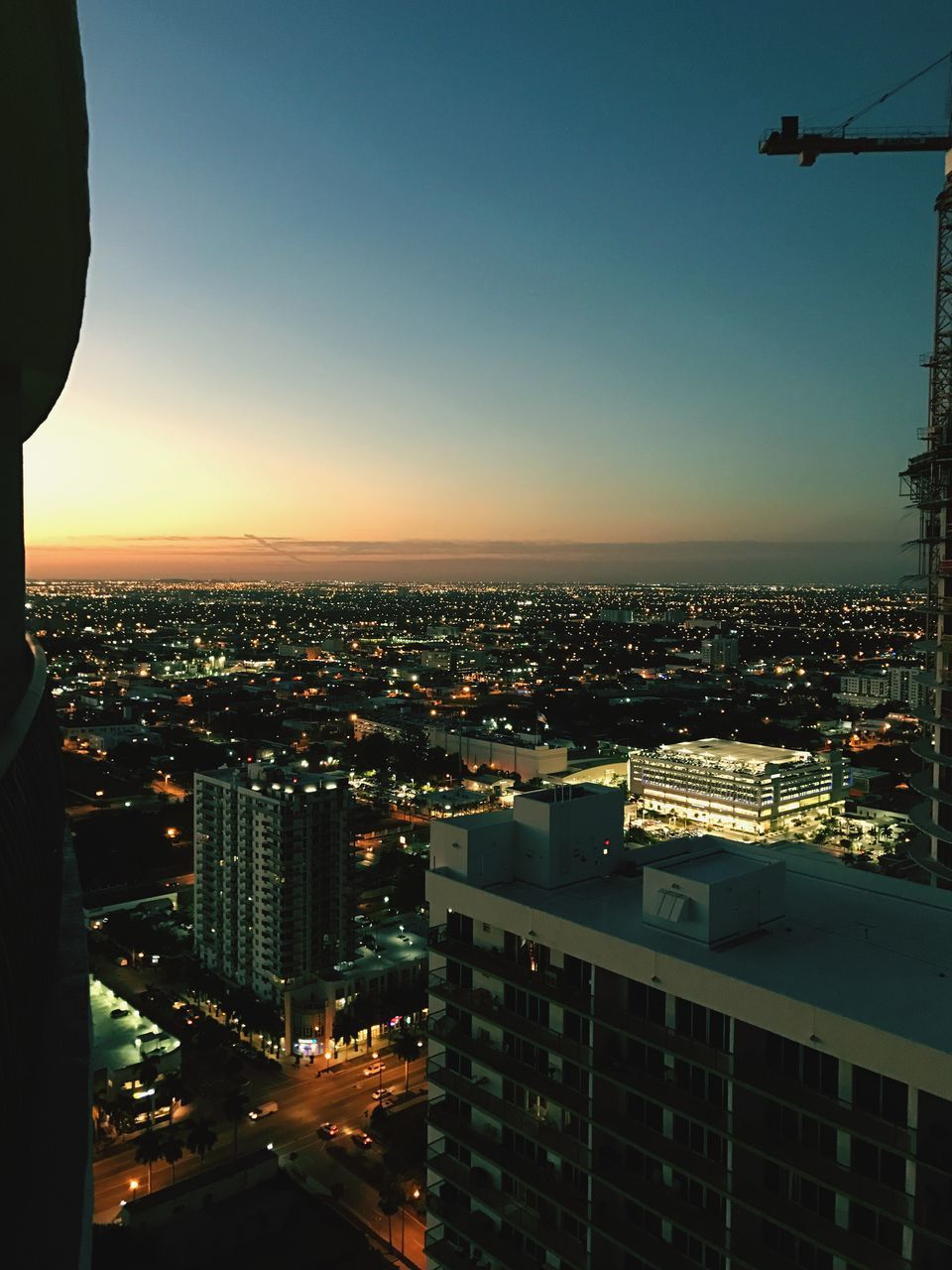 cityscape, city, architecture, building exterior, built structure, sky, no people, skyscraper, outdoors, modern, sunset, illuminated, clear sky, day