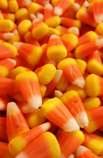 Fresh bulk candy corn Abundance Autumn Backgrounds Candy Candy Corn Choice Close-up Detail Food For Sale Freshness Full Frame Halloween Heap Large Group Of Objects Market Multi Colored No People Orange Color Organic Repetition Retail  Still Life Yellow Yummy