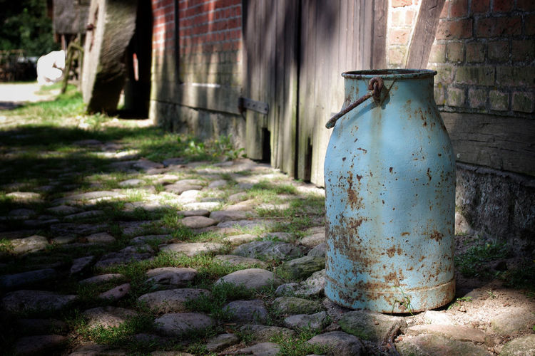 the old milk can Milk Can Shadows & Lights The Week On EyeEm Abandoned Architecture Building Exterior Built Structure Close-up Day Focus On Foreground Light And Shadow Milkcan No People Old Old Ruin Old-fashioned Outdoors Outside Pentax Selective Focus Shadows Sunny Day