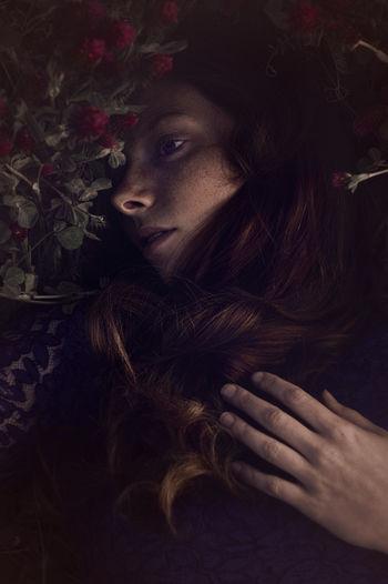 High angle view of beautiful woman lying down on plants