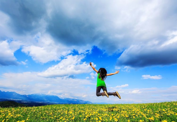 Freedom of life Sky One Person Cloud - Sky Field Nature Mid-air Full Length Beauty In Nature Day Outdoors Motion Jumping Scenics Tranquility Women Real People Landscape Energetic Flying People Rural Scene