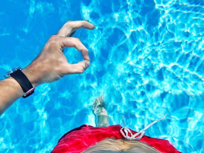 Swimming Pool Water Real People One Person Blue Human Body Part High Angle View Day Leisure Activity Outdoors Low Section Lifestyles Sunlight Human Hand Nature Close-up People EyeEmNewHere Summer Sommergefühle Watch EyeEm Selects