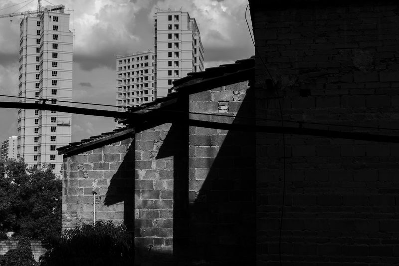 light on the wall Black And White Monochrome Blackandwhite Built Structure Building Exterior Architecture No People Nature Day The Architect - 2018 EyeEm Awards City Low Angle View Building Sunlight Shadow Brick
