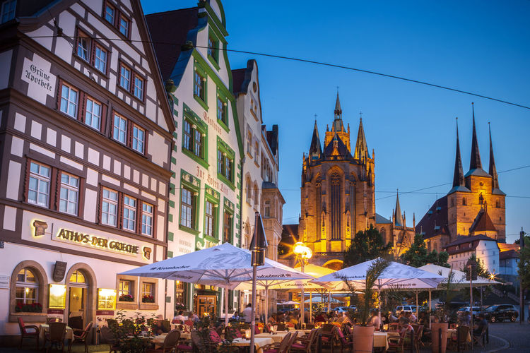 Cityscape of Erfurt town in Germany City, Erfurt, The Erfurt Cathedral, Town, Architecture, Building, Center, Church, Cityscape, Culture, Europe, European, Germany, Historic, House, Landmark, Landscape, Old, Outdoors, Palace, Park, People, Place, Plants, Square, Stone, Thuringia, Tourism, T Erfurt Town Scape City Architecture Domestic Animals Street Building Exterior Built Structure Building Illuminated Sky Travel Destinations Group Of People Religion Dusk Nature Belief Place Of Worship Incidental People Spirituality Travel Tourism Outdoors