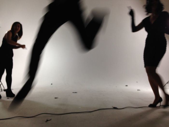 People creating an active photo shoot in a studio