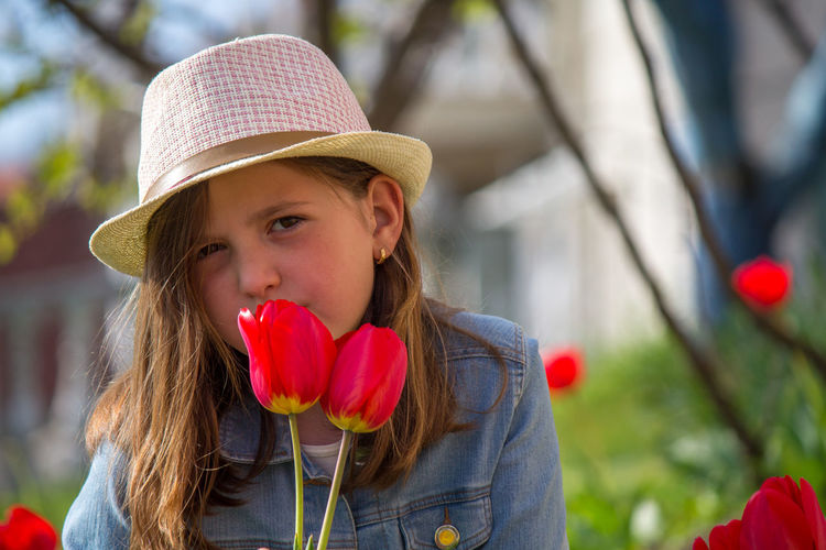 Portrait of girl with red flowers