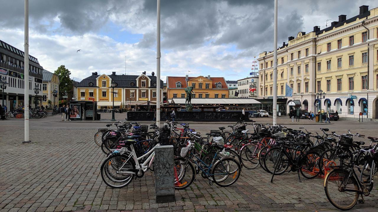 BICYCLES AGAINST BUILDINGS IN CITY