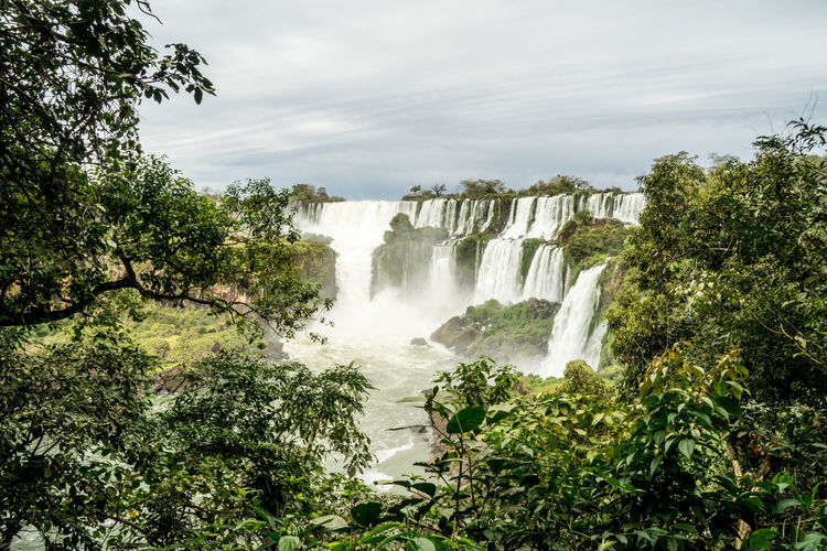 Scenic view of waterfall in iguazu against sky
