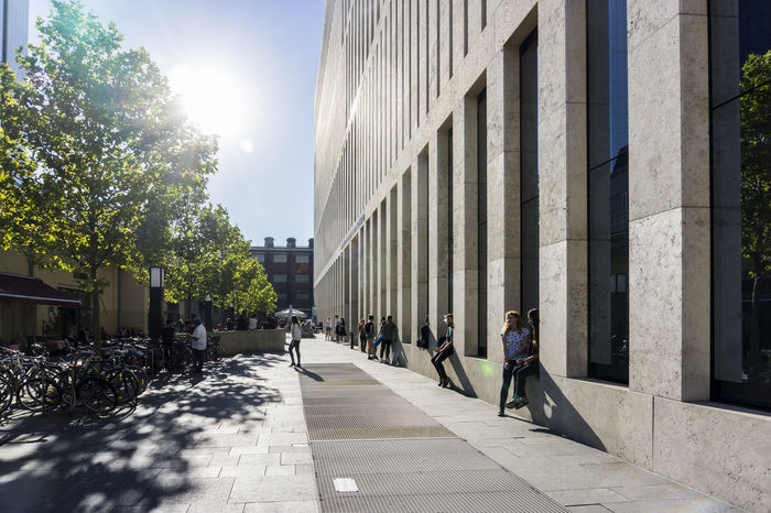 Humboldt University building in Berlin, Germany Adult Adults Only Architecture Berlin Building Exterior Built Structure City Color Image Day Germany🇩🇪 Horizontal Humboldt University Berlin Jocob-and-Wilhelm-Grimm Center Outdoors People Photography Sun Unrecognizable People Walking