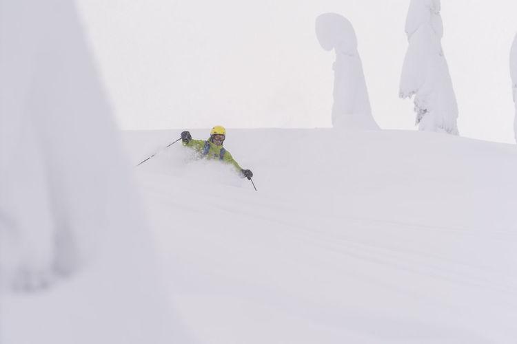 People skiing in snow