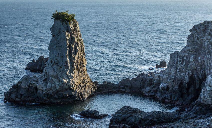 Rock Formation In Sea At Jeju Island
