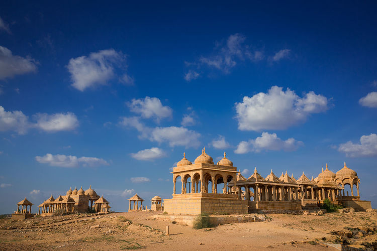 Cemetery Chhatri Desert India Ancient Archaeology Architecture Blue Building Cenotaph Chattri Cloud - Sky Day Desert History Jaisalmer Land No People Outdoors Sky Sunlight The Past Tourism Travel Travel Destinations The Architect - 2018 EyeEm Awards The Great Outdoors - 2018 EyeEm Awards