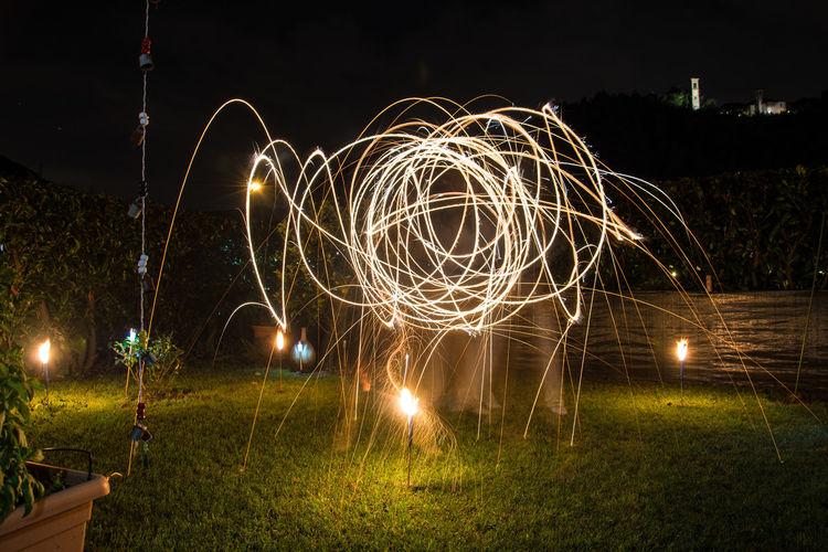 Sparks Of Light Over Grassland