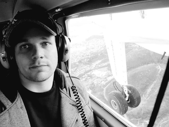 Portrait of man sitting in helicopter