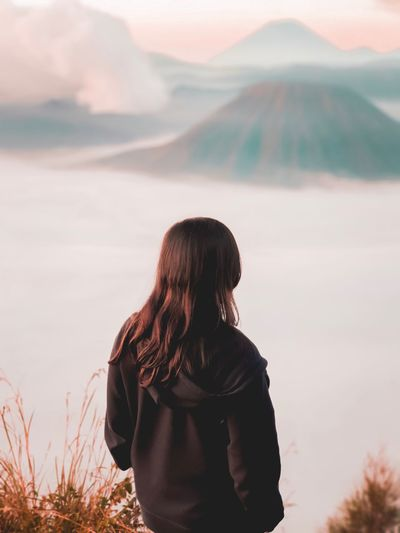 Rear view of woman looking at mt bromo