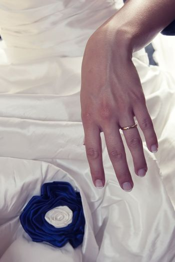 Midsection of bride wearing ring during wedding celebration
