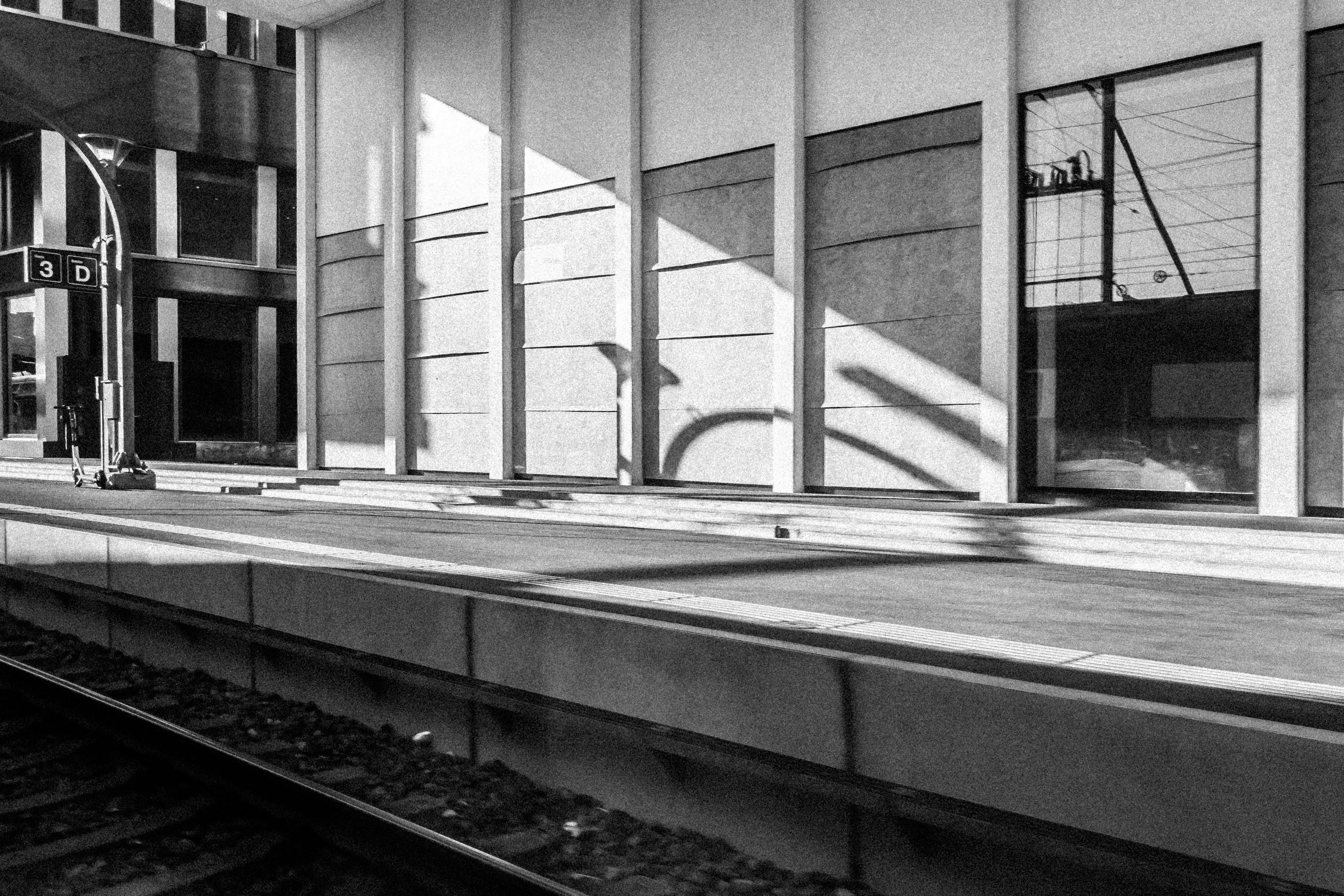 architecture, built structure, track, rail transportation, railroad track, black and white, building exterior, transportation, no people, monochrome, monochrome photography, public transportation, day, transport, railroad station, mode of transportation, railroad station platform, window, building, outdoors