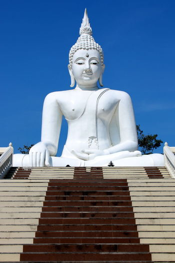 Architecture Religion Belief Spirituality Built Structure Sculpture Art And Craft Sky Place Of Worship Building Statue Human Representation No People Representation Male Likeness Day Low Angle View Buddha Statue Buddha Statue In Thai White Buddha White Buddha Statue