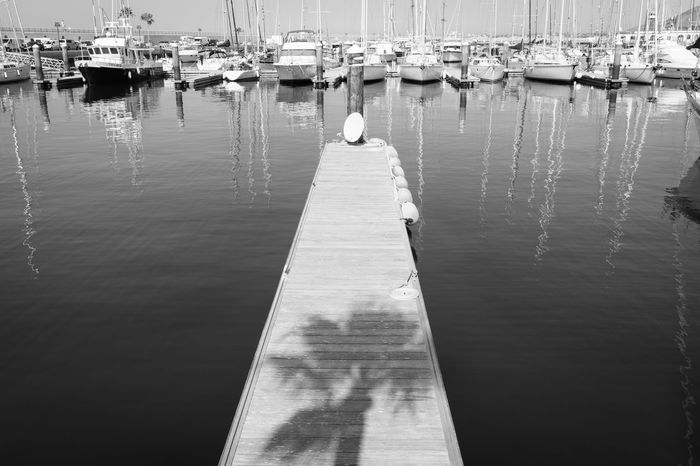 Playing With Light, Reflections & Shadows. Art Is Everywhere Holiday Lanzarote Island Nature Palm Tree Puerto Blanca The Week On EyeEm Travel Blackandwhite Photography Day Fishing Harbor Moored Nature Nautical Vessel No People Outdoors Playing With Light Reflection Reflections In The Water Sea Sea And Sky Shadows Water Yacht
