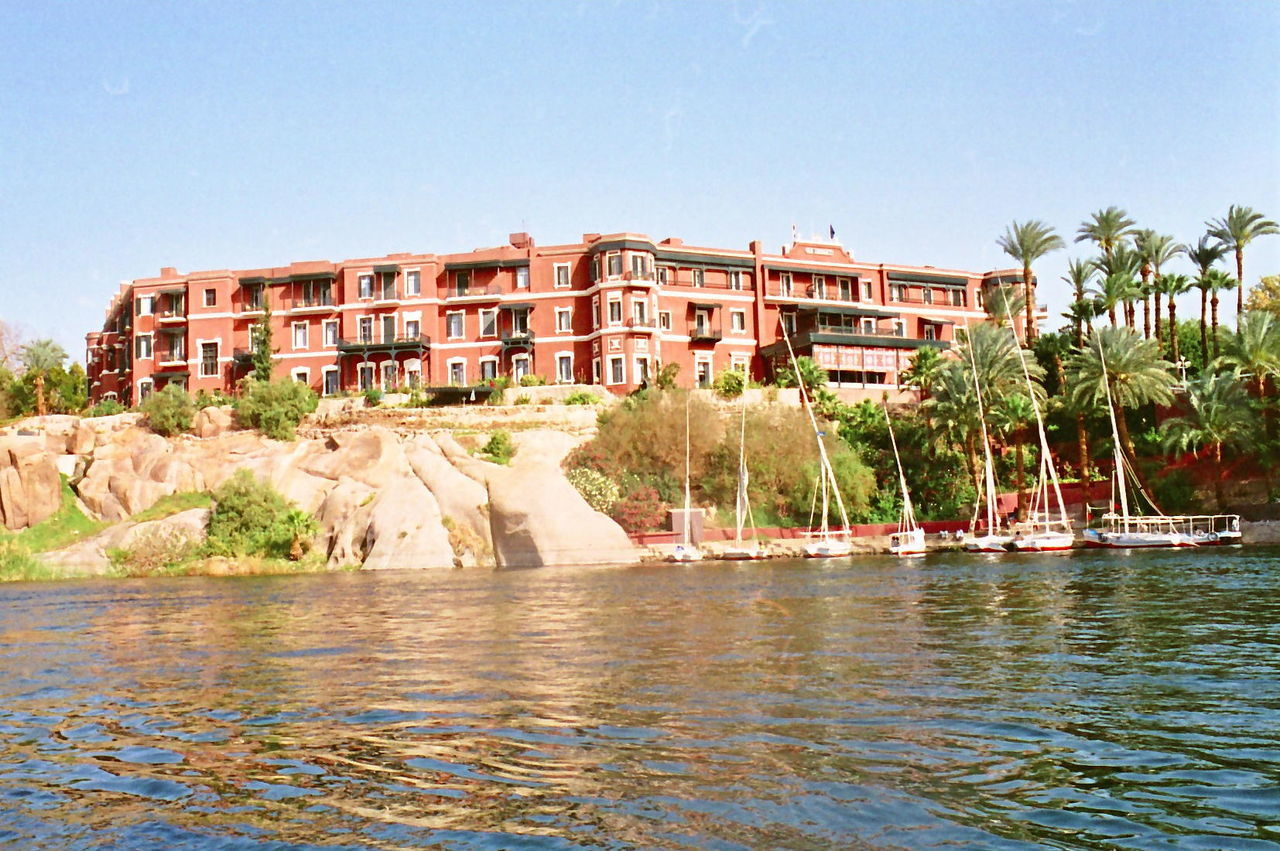Cataract Hotel where Agatha Christy wrote Cataract Architecture Aswan Building Building Exterior Built Structure Capital Cities  City City Life Clear Sky Community Culture Egypt Hotel Nile Nile River Outdoors Palm Trees River Travel Destinations Voyage Water