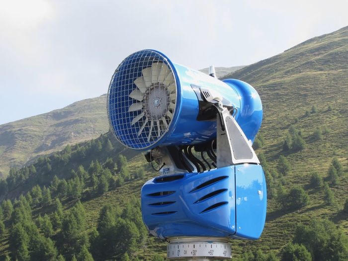 Snow cannon with mountains background in summertime . Sesto Dolomites, South Tyrol, Italy Alpine Artificial Blower Cannon Canon Dolomites Equipment Fan Forest Generator Italy Mountains Sesto  Sexten Snow Snow-cannon Snow-machine Snow-shower Snowblower Snowcannon Snowgun Snowmaker Snowmaking Turbine Tyrol