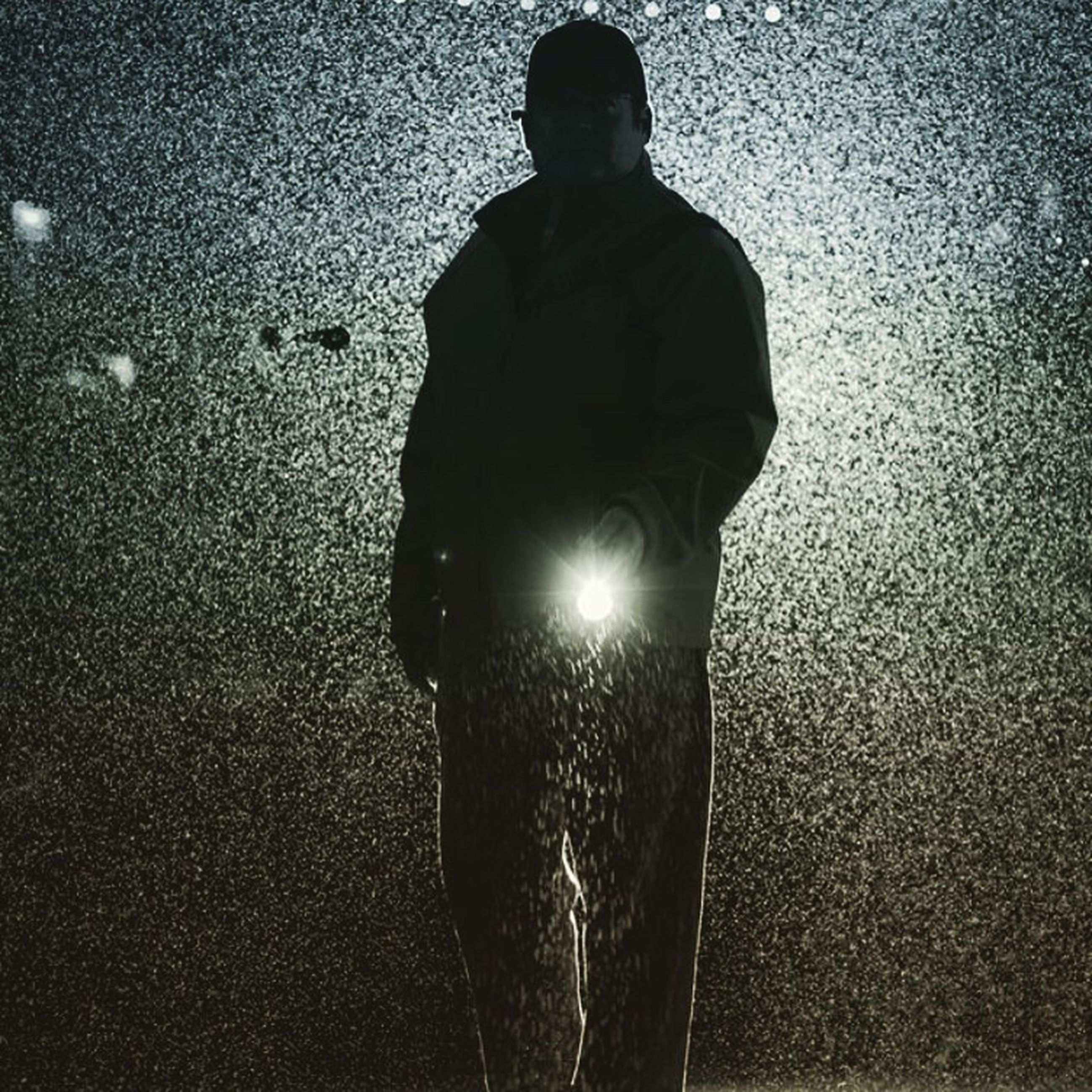 standing, night, lifestyles, shadow, men, sunlight, street, close-up, leisure activity, outdoors, reflection, unrecognizable person, dark, silhouette, person, human representation, illuminated, copy space