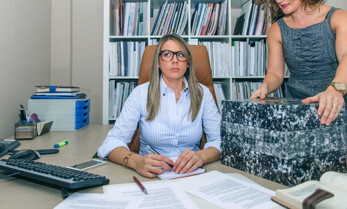 Portrait of tired blonde secretary receiving folders stack to work Angry Blonde Burden Business Busy Chair Company Hard Horizontal Office Receptionist Woman Working Assistant Beauty Business Finance And Industry Businesswoman Female Phone Sad Secretary Smart Phone Stressed Tired Two People