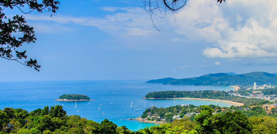Beautiful landscape of turquoise ocean waves with boats, coastline and blue sky background from high aerial view point of Kata and Karon beaches in Phuket Thailand. Aerial View Of Beach Coastline Coastline Landscape Coastline Nature Water Karon Beach, Phuket Kata Beach Kata Beach,Phuket Thailand Kata Beach Phuket, Thai Seashore Aerial View Beauty In Nature Blue Cloud - Sky Coastline Beauty Coastline Sky Day Foreground Growth Horizon Over Water Karon Karon Beach Karon View Point Kata Landscape Nature No People Ocean Wave. Ocean Waves Ocean Waves Hits The Rock Outdoors Scenics Sea Seascape Seaside Sky Tranquil Scene Tranquility Tree Turquoise Turquoise Sea Water
