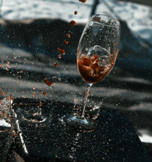 High angle view of drink splashing on table