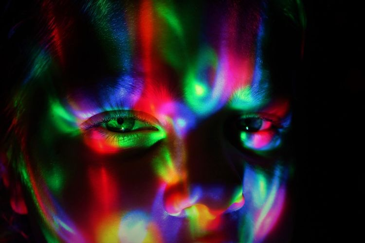Multi Colored Portrait Vibrant Color Human Body Part Adult Neon Beauty Illuminated Young Adult Black Background Beautiful Woman Body Part One Person Dark Close-up Futuristic Green Color Studio Shot Paint Fashion Human Face Neon Colored Projection Saturated Color