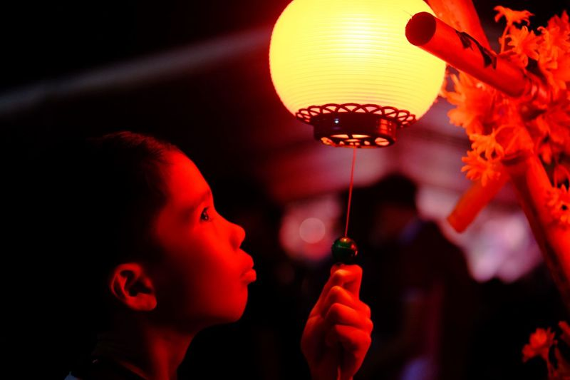 One Person Illuminated Real People Lighting Equipment Headshot Focus On Foreground Portrait Indoors  Red Side View Chinese Lantern Lantern Close-up Leisure Activity Lifestyles Glowing Celebration Innocence Child Childhood