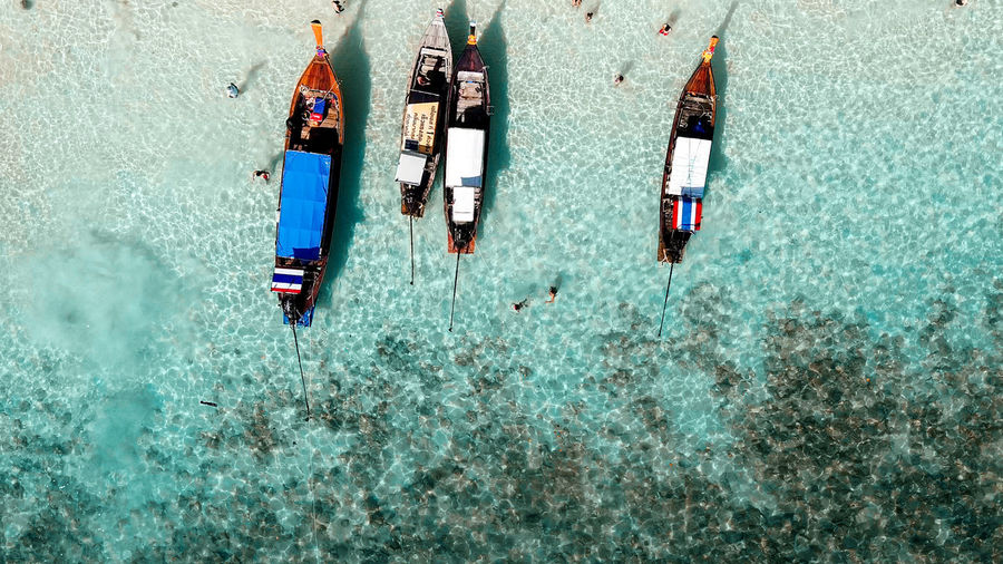 High angle view of boats moored in sea
