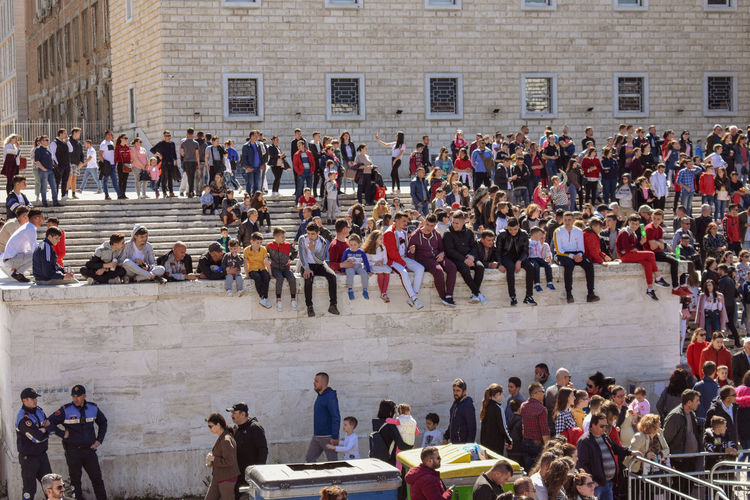 High angle view of people standing outside historic building