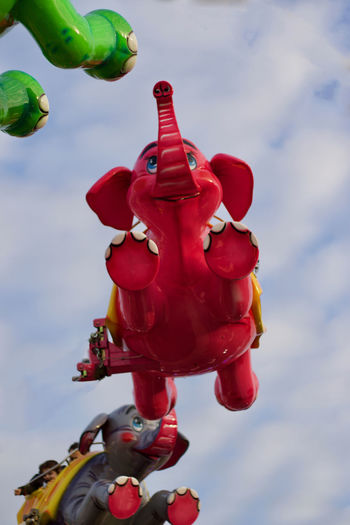The flying Red Elephant Colours Happiness London Red Elephant Amusement Park Amusement Park Ride Amusement Parks Amusementpark Animal Representation Elephant Elephants Enjoying Life Flying Hanging Low Angle View Sky Fairground Ride Fairground