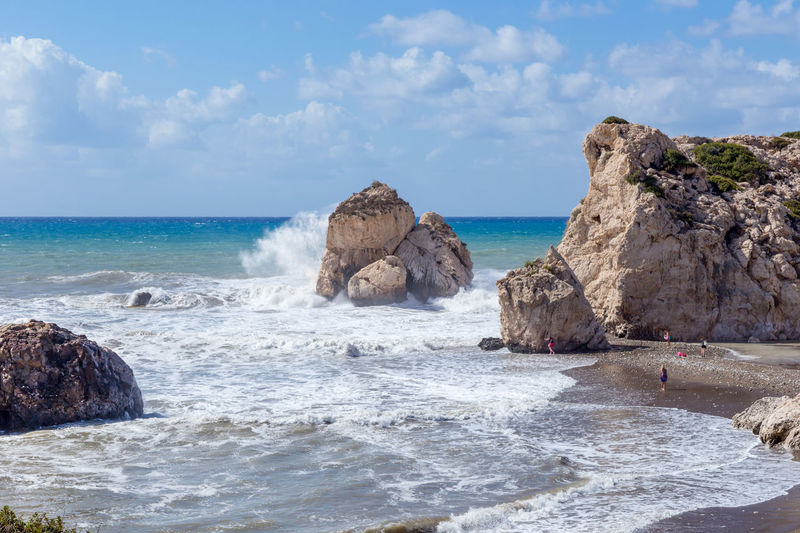 Aphrodite's Rock on a stormy day with large waves crashing on the rock. Aphrophodite's Rock Beauty In Nature Cloud - Sky Cyprus Day Godess Horizon Over Water Mythology Nature Outdoors Power In Nature Rock - Object Rock Formation Scenics Sea Sky Stormy Weather Water Wave